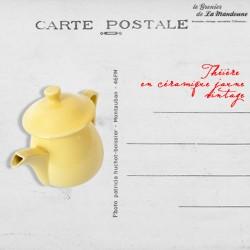 Théière en céramique jaune vintage