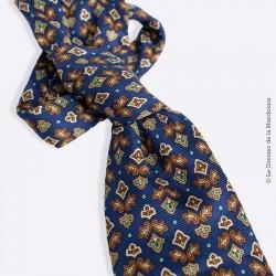 Cravate en soie Pierre Cardin Vintage, motif fleur de lys stylisé sur fond bleu marine