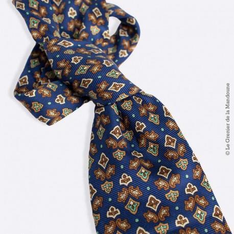 Cravate en soie grise Pierre Cardin Vintage, motif fleur de lys stylisé sur fond bleu marine