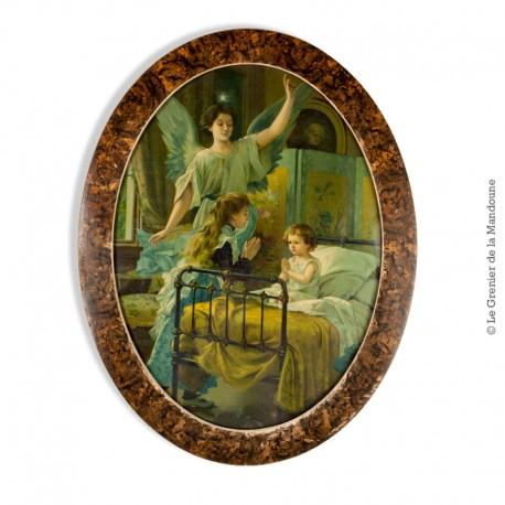 Le Grenier de la Mandoune. Chromolithographie  l'Ange gardien vers 1900, sous verre , encadrement ovale, 46 x 36 cm