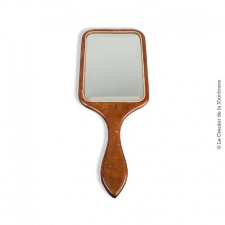 Le Grenier de la Mandoune. Miroir à main ancien. Bois verni et glace biseautée